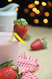 Glass of strawberry milkshake Royalty Free Stock Photography