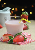 Glass of strawberry milkshake Stock Photos