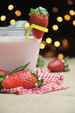 Glass of strawberry milkshake Stock Image