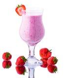 Glass of strawberry milkshake on a white background Royalty Free Stock Photography