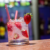 Glass of strawberry mojito. On marble table Royalty Free Stock Photography
