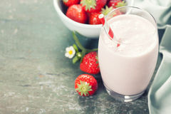 A glass of strawberry smoothie Royalty Free Stock Photos
