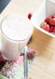 Glass of strawberry yogurt Stock Photos