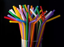 Glass with straws Royalty Free Stock Images