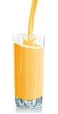 Glass of stream orange juice Stock Photo
