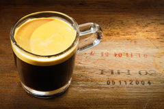 Glass of strong frothy coffee Stock Images
