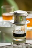 Glass of strong vietnamese filter coffee Royalty Free Stock Photo