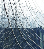 Glass Struture. Steel rod support against reflective glass structure Royalty Free Stock Images