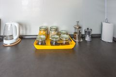 Glass stylish vintage jars with different food and teapot in Interior of the modern kitchen in loft flat apartment in minimalistic royalty free stock image