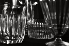 Glass subjects on a black background. Glasswares (glasses, wine glasses) on a black background Stock Image