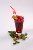 Glass of summer fresh juice. Summer juice with fresh raspberries and passion fruit, white background Stock Image