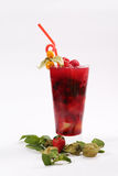 Glass of summer fresh juice. Summer juice with fresh raspberries and passion fruit, white background Stock Images