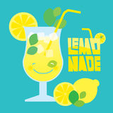 Glass of summer lemonade drink on blue background Royalty Free Stock Image