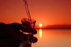 Glass and sunset Stock Photos