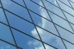 Glass surface of a building with reflection of a cloud Stock Photo