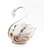 Glass swan - stand for napkins. Royalty Free Stock Photos