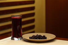Glass of sweet mors and plate with ingredients Stock Image
