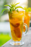 Glass of sweet peach iced tea Stock Image