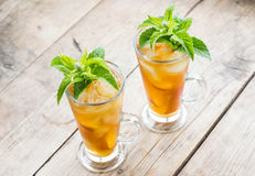 Glass of sweet peach iced tea Royalty Free Stock Photos