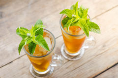 Glass of sweet peach iced tea Royalty Free Stock Image