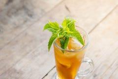 Glass of sweet peach iced tea Stock Photo