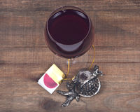 Glass of sweet pomegranate wine and pomegranate shabbat metal decoration Stock Photography