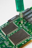 Glass syringe and circuit board Royalty Free Stock Image