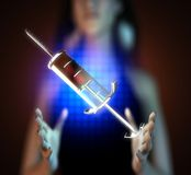 Glass syringe on futuristic  hologram Stock Photo