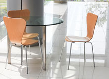 A glass table and chairs Royalty Free Stock Images