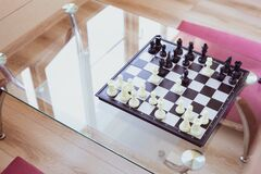 on a glass table chess games with children and adults