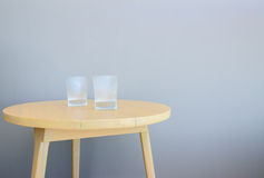 Glass on table Stock Image
