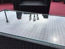 Glass tabletop reflecting light Stock Photo