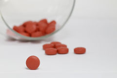 Glass of tablets Stock Images