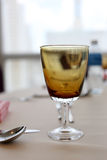 Glass on the tableware. Royalty Free Stock Images