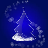 Glass tag in the form of a Christmas tree with snowflakes. On a blue background Stock Photos