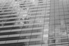 Glass of the tall building with the glare of black and white col Royalty Free Stock Photography