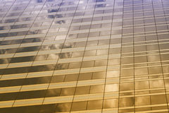 Glass of the tall building with the glare of yellow and purple c Stock Photo