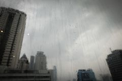 Glass on a tall building with a rainy. The glass on a tall building with a rainy, lonely and sad mood, background texture royalty free stock photography