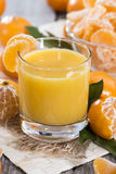 Glass with Tangerine Juice Royalty Free Stock Images