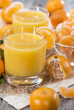 Glass with Tangerine Juice Stock Images