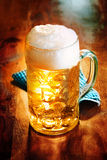 Glass tankard of frothy craft beer stock photography