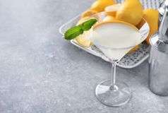 Glass with tasty lemon drop martini cocktail. On table Royalty Free Stock Photo