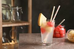 Glass with tasty melon and watermelon ball drink. On table stock images