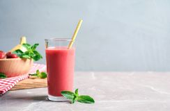 Glass with tasty strawberry smoothie. On table stock photos