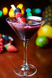 Glass of tasty tropical cocktail with berries or lemonade. Royalty Free Stock Photography