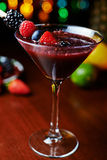 Glass of tasty tropical cocktail with berries or lemonade. Royalty Free Stock Photo