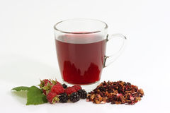Glass of Tea. Fruit Tea with fresh raspberry on birght background stock image