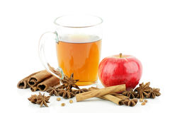 Glass of tea. A glass of tea with apple and spices,on a white background royalty free stock photography