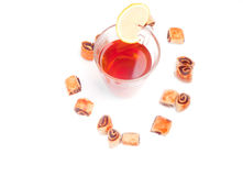 Glass of tea with biscuits around Stock Images