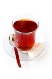 Glass of tea with cube sugars stock photography
